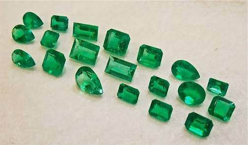 price multicolour pair photo emeralds main c tanzanian courtesy untreated weighing gems how emerald quora determined of the qimg cts is