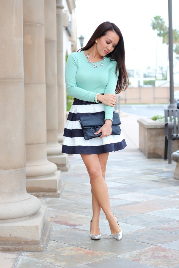 2f77fbbd4 Pair a pretty Striped Skirt, with a colorful plain top. Complete this outfit  with a pair of Pumps to make your looks more dressy.