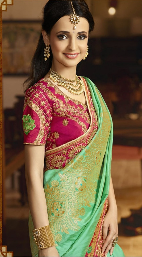 9f9d7a10e08b3 Orange chic blouse  Contemporary blouse designs are sleek and smart. A  orange high neck blouse with collar looks hot with a soft saree