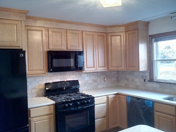 Why Don T Most Kitchen Cabinets Touch The Ceiling Quora