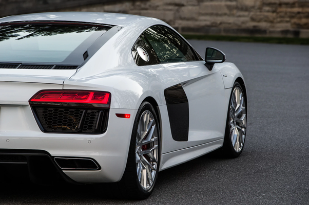 Should I Buy An Audi R8 V10 Plus Or A Lamborghini Huracan Quora
