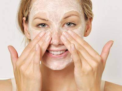 Picture of a lady with face cream