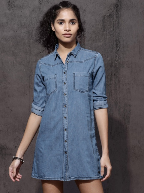 10e9eacebd 4) Some slip on sneakers and an easy statement necklace is all you need to  put together a simple look with your denim dress.