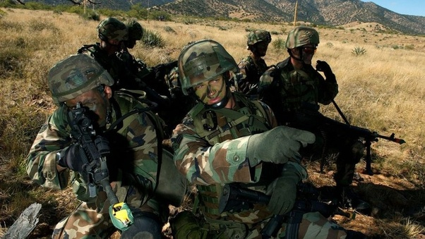 In the US Army, what changes in personal combat gear (clothing, pack