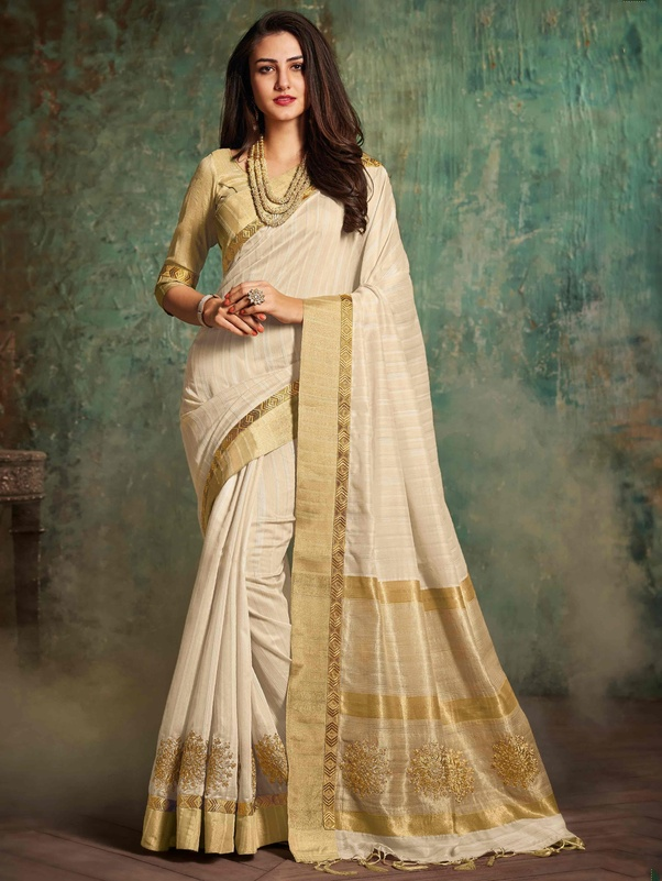 534d64ab1953a Which colour of blouse will suit a plain cream silk saree  - Quora
