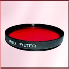 So, When You Look At It From The Other Side All You See Is Red Light And  Hence The Filter Itself Looks Red.