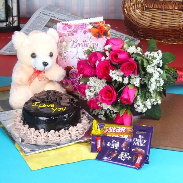 12 Pink Roses Hand Tied Bunch 1 2 Kg Chocolate Cake Teddy Bear Size Inches 5 Bars Of Mix Chocolates Along With Birthday Greeting Card