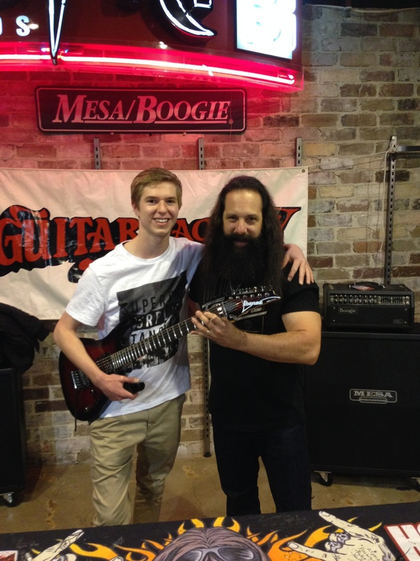 What is john petrucci like in real life quora eager fans on a daily basis at guitar clinics concerts meet and greets etc finally i got a photo alongside my signed guitar which is now one of my m4hsunfo