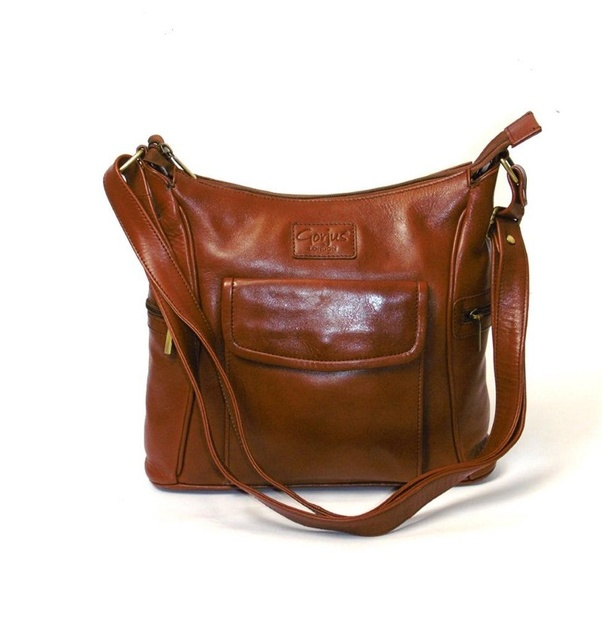 e9a772eb17cc This Veg tanned real leather shoulder and crossbody bag is perfect for any  professional woman. It features front flap button down pocket