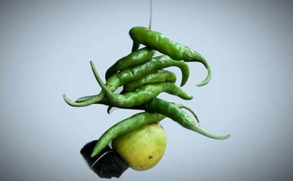 What is the significance in India of hanging lemon and chili tied to
