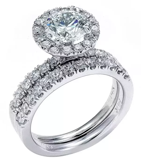Traditionally A Plain Gold Band Is Not Used As The Engagement Ring An Has One Main Larger Diamond Or Other Gemstone With