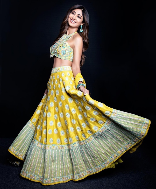 0b7b4791c750bc She always shows her glamorous looks in saree. You can get some ideas from  her outfits, as her blouse designs are always unique, trendy & uber cool.