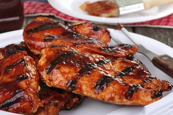 Barbecue fish BBQ salmon fillet with spicy Salsa from the grill with fiery