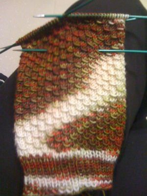 Brown and white yarn, pooling into blob of colour.