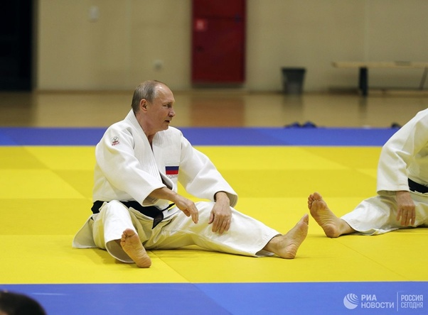 President Putin doing warm-up before a judo training session