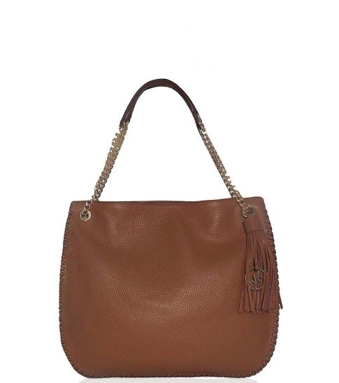 c49f118f8d04 Michael Kors bags are definitely made with genuine leather but there are  some Michael Kors bags which are made with other fabrics like suede,  polyester and ...