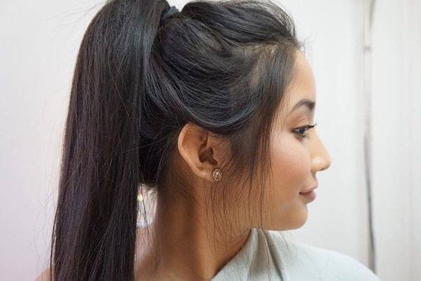 Should a girl put her hair up in a ponytail or down? Does the face ...