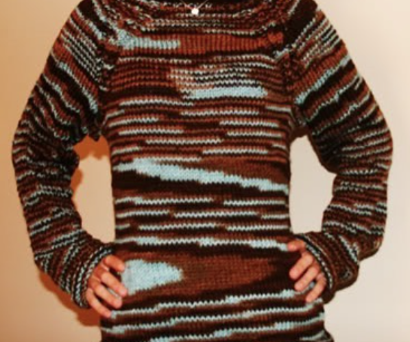 A sweater with unplanned pooling, where the yarn has broken into swirls and patches of colour.