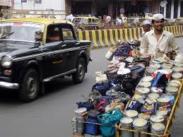 mumbai dabbawalah A dabbawala (tiffin wallah) is a person in mumbai who collects tiffin boxes from the residences of the office workers and delivering at their respective workplaces and returning back the empty boxes by using different ways of transport.