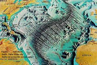 What is an example of a mid ocean ridge quora ridge travels around the earth for 40000 miles like the seams of a baseball it surfaces on the country of iceland where it it is spreading apart gumiabroncs Images
