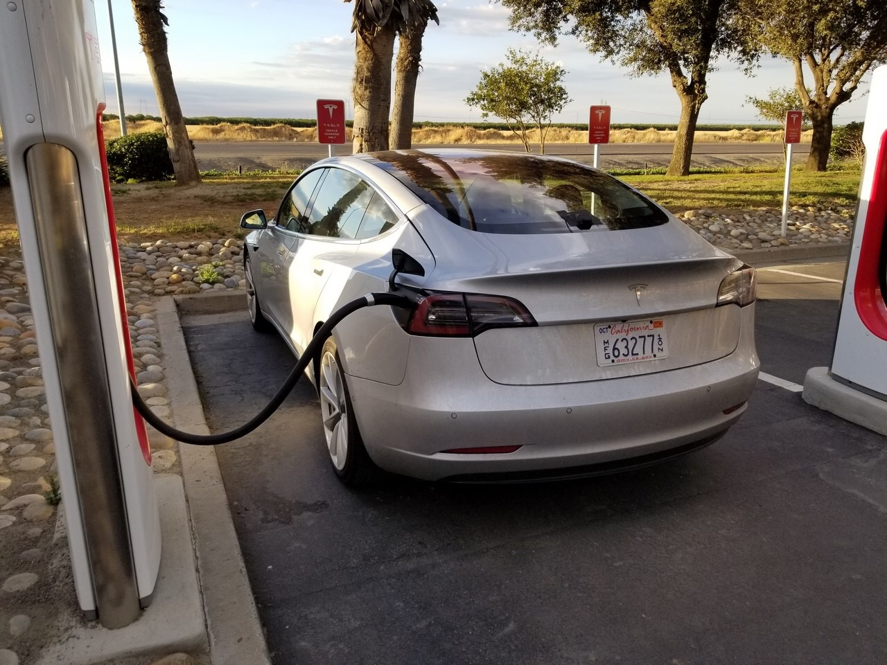 Where is the charging plug located in the Tesla Model 3? - Quora