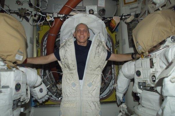 Astronauts sleeping in space