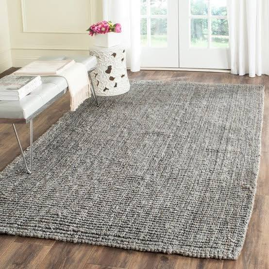 difference between a carpet and a rug