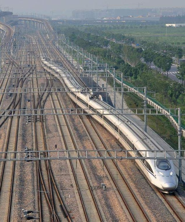 Can high-speed trains travel on regular train tracks albeit
