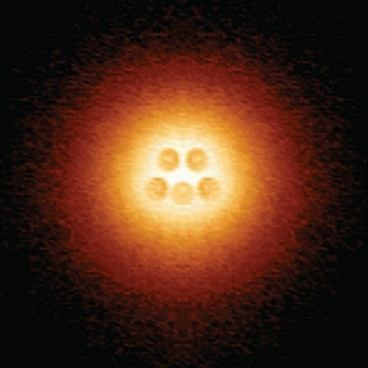 Scanning Tunneling Microscope Image Shows An Artificial Atomic Nucleus On Graphene Consisting Of Five Pairs Calcium Atoms Slightly Darker Circles At