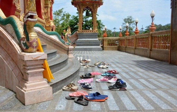Why we remove footwear before entering Temple?