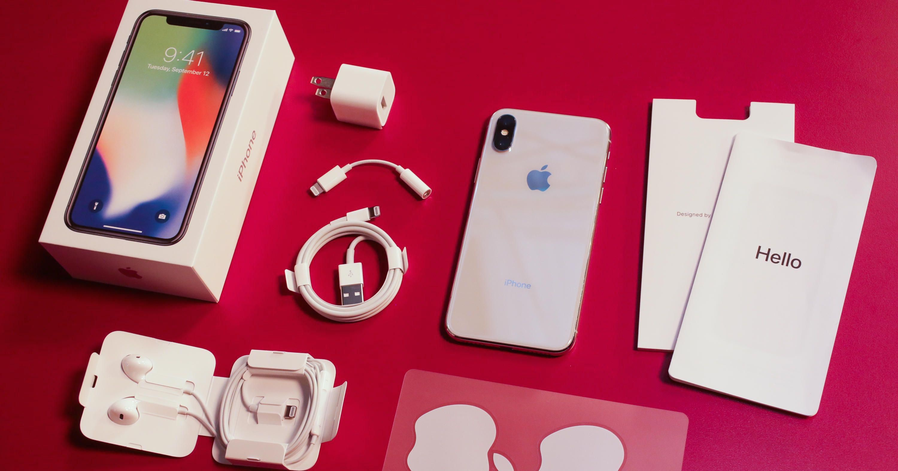What are the accessories provided in the box of an iPhone X