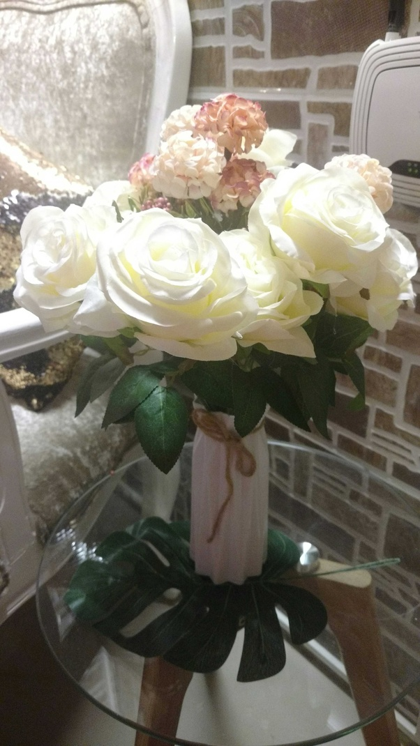 d970707964 These stunning bunch of artificial flowers and the white vase.