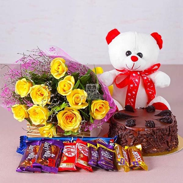 Bouquet Of 10 Yellow Roses And Teddy Bear Size 6 Inches With Assorted Cadbury Chocolate Bars Worth Rs Each Along Half Kg Choco Chips