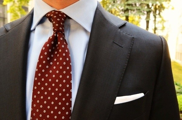 Tie black suit blue shirt