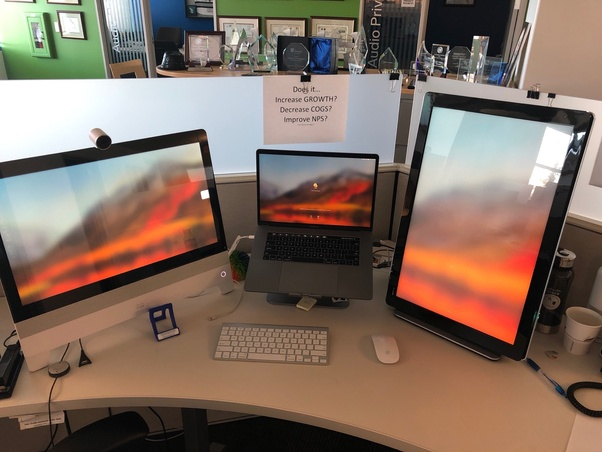 Why are dual monitors more common today than three monitors? Wouldn