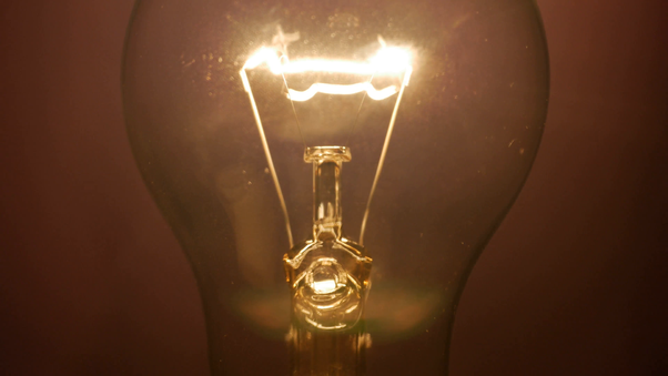 This is a picture of an incandescent filament in a clear bulb so you can see the glowing filament. Normally it would be run much brighter. & What are examples of an incandescent light source? - Quora
