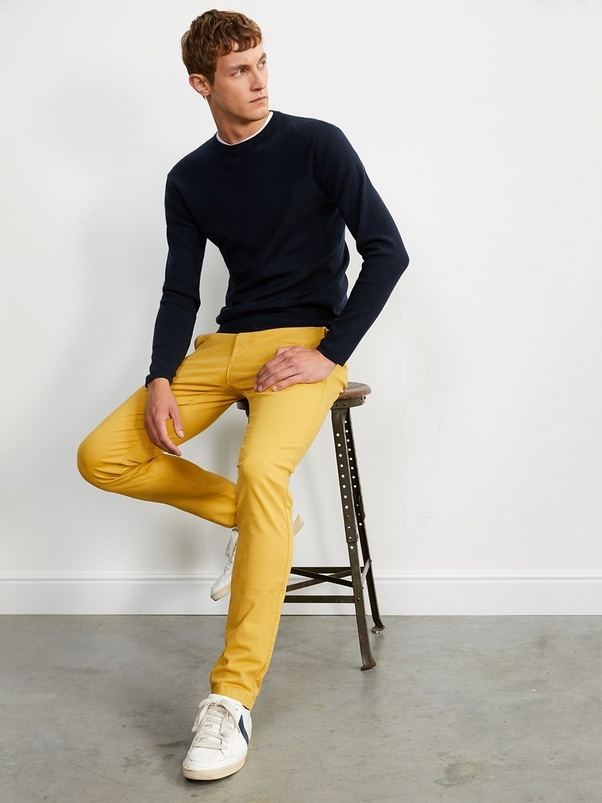 56da84eec11 Navy jumper and yellow chinos – You can swap the jumper for a navy shirt