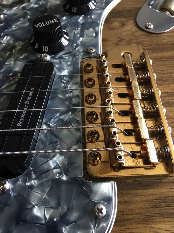 how to reduce the large gap between my guitar 39 s fret board and strings quora. Black Bedroom Furniture Sets. Home Design Ideas