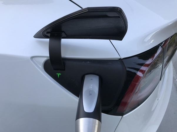 Where is the charging plug located in the Tesla Model 3 ...