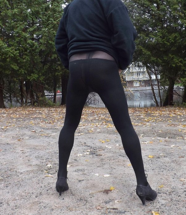 Skinny legs in pantyhose, leather strap for penis pumping