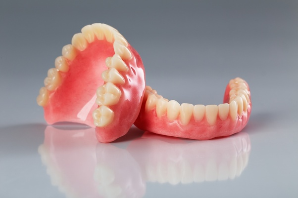 How much to pull all teeth and get dentures