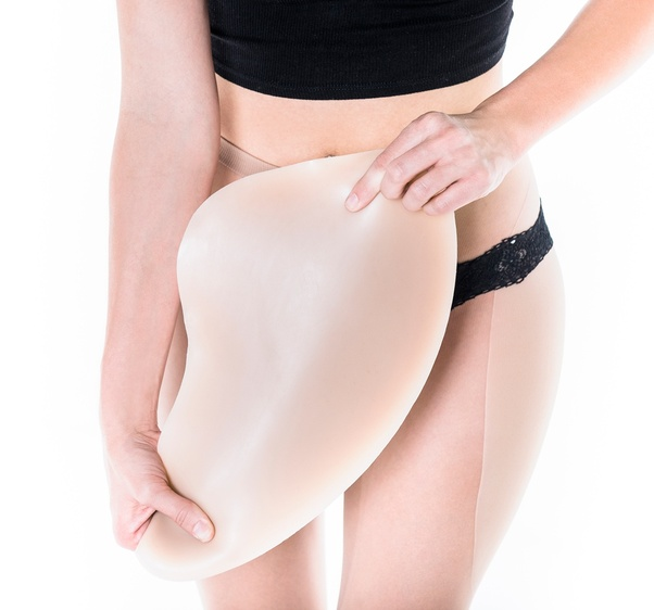 There are also shapewear solutions that give the appearance of curvy hips.  A variety of companies make foam or silicone padding to shape the hips.