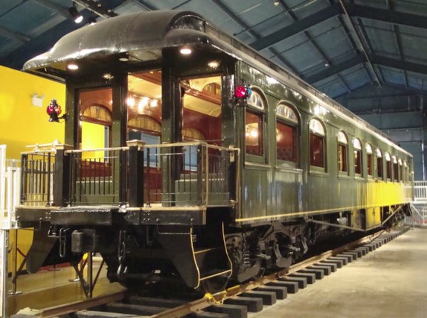 Can a person buy a railway car, customize it, and attach it to