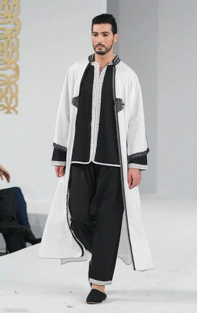 57b18066788 They are also traditional clothes composed of a tunic and loose pants (for  both men and women)