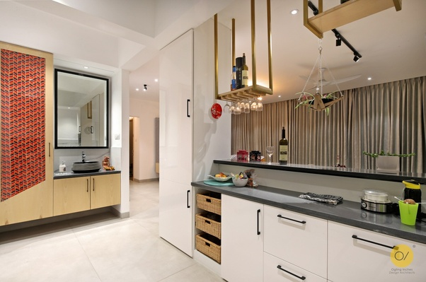 Modern apartment modern kitchen kitchen with white cabinets & custom hanging wine holders