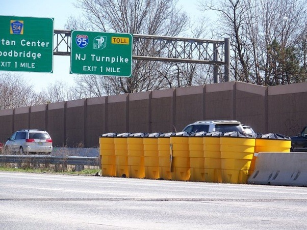 You Drive Defensively When You >> In America, do you really have those yellow barrels full of water on your highway exits? Why ...