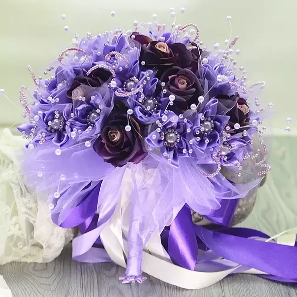 How much did you spend on your wedding flowers was it worth the i got my bouquet with artificial flowers from a online store trust me it look like real flowers and it is beautiful as well and cheap mightylinksfo