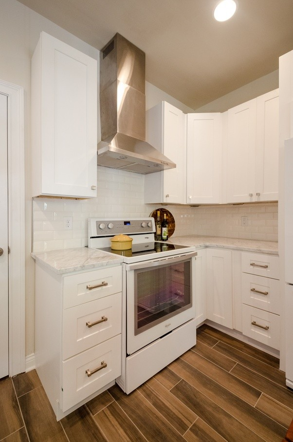White Cabinets, Black Counter, White Penny Tile Backsplash: