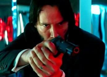 Is holding a gun sideways like how john wick holds his for John wicks back tattoo