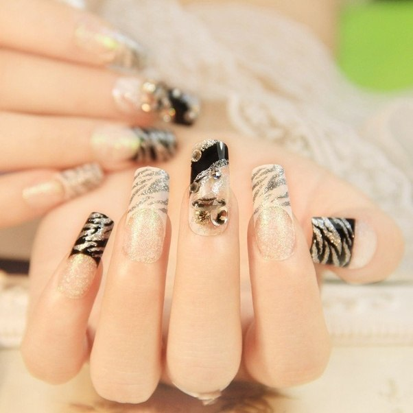 Why do some African American women like to wear long fake nails? - Quora